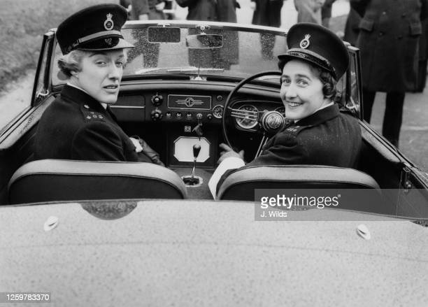 Dorothy Farrant and WPC Elizabeth Fisher of one of Britain's first mobile patrols crewed solely by female police officers, at the wheel of a...