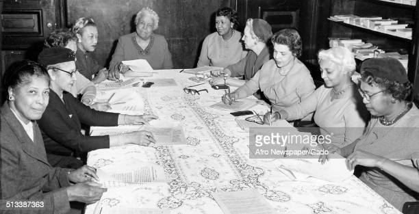 Dorothy Ferebee educator and Civil Rights activist Mary McLeod Bethune and educator and Civil Rights activist Dorothy Height sitting at a table...