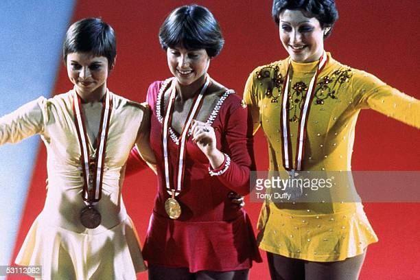 Dorothy Hamill in the center smile while wearing her gold medel at the Winter Olympics skating competition in 1976 in Innsbruck Austria Dorothy...