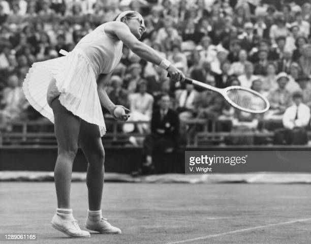 Dorothy Head Knode of the United States serves to Christine Truman during the singles match of the 30th edition of the Wightman Cup women's team...