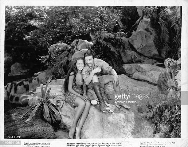 Dorothy Lamour sitting and smiling with Ray Milland in a scene from the film 'The Jungle Princess', 1936.