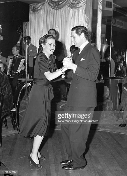 Dorothy Lamour steps out in a snappy rhumba with Philip Reed at the Stock Club It seems that Paramount tossed a cocktail party for Dotty strictly on...