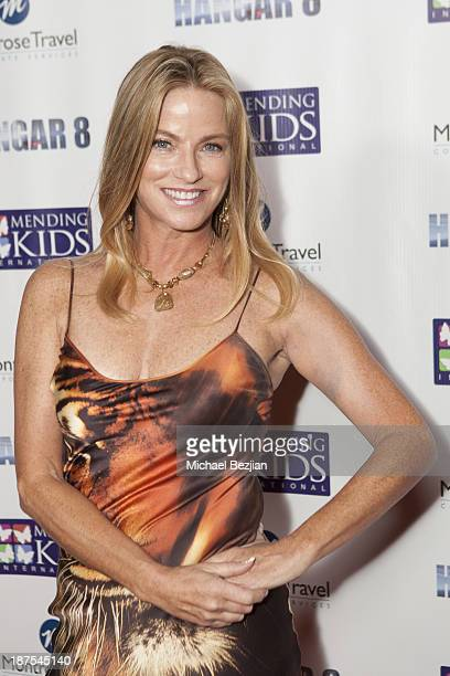 Dorothy Lucey attends Mending Kids International's Wings Around The World African Safari Gala Red Carpet at Santa Monica Airport on November 9 2013...