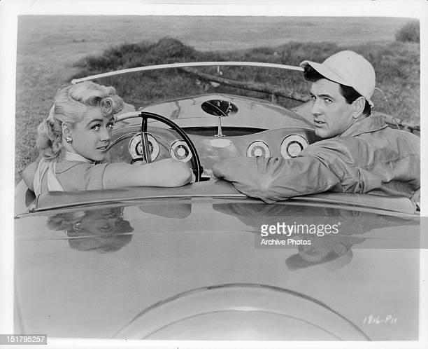 Dorothy Malone and Rock Hudson in a car in a promotional portrait for the film 'Written On The Wind', 1956.