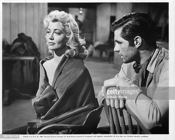 Dorothy Malone gives a cold shoulder to John Gavin in a scene from the film 'Quantez' 1957