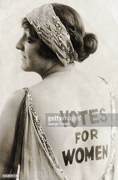 Dorothy Newell an outgoing young woman with a sense of humor promotes women's enfranchisement by wearing the words 'Votes for Women' emblazoned on...