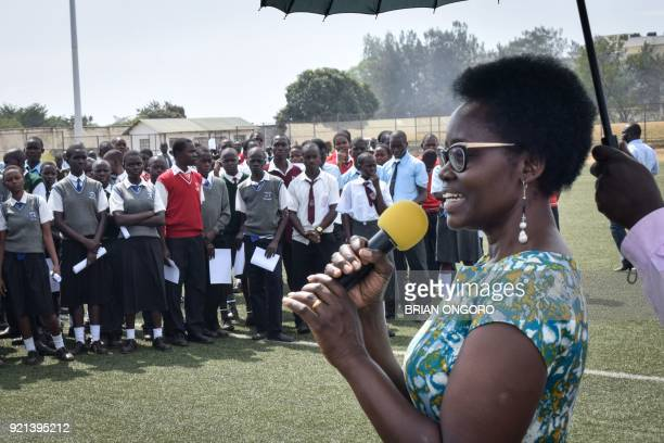 Dorothy Nyong'o mother of Oscar winning Kenyan actress Lupita Nyong'o speaks to students before watching the film 'Black Panther' featuring her...