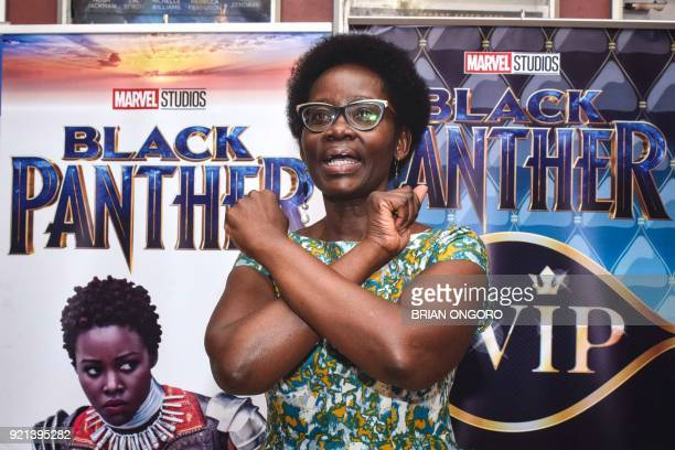 Dorothy Nyong'o mother of Oscar winning Kenyan actress Lupita Nyong'o poses in front of banners before watching the film 'Black Panther' featuring...