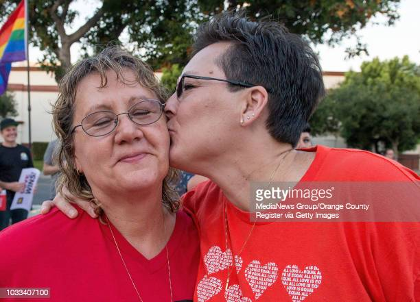 Dorothy Phillips left gets a kiss from her wife Lisa Johnson during a rally in downtown Santa Ana to celebrate the Supreme Court ruling on same sex...