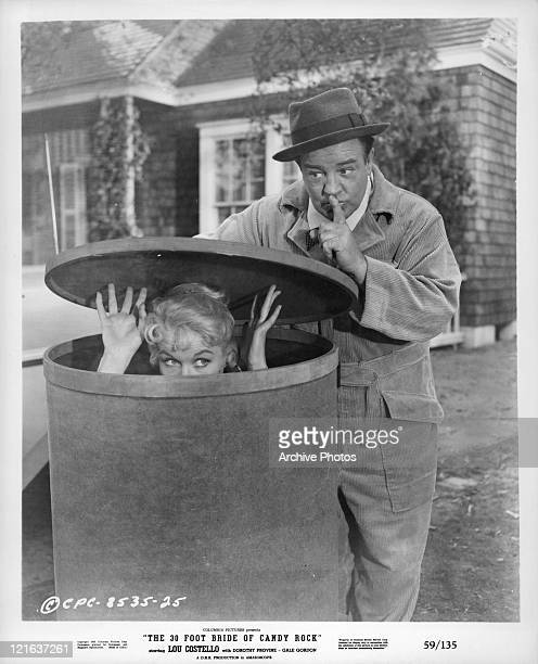 Dorothy Provine hides in canister as Lou Costello admonishes her to be quiet in a scene from the film 'The 30 Foot Bride Of Candy Rock' 1959