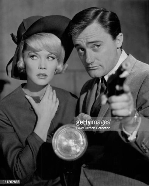 Dorothy Provine US singer and actress and Robert Vaughn US actor who is pointing a gun with one hand holding a torch in the other in a publicity...