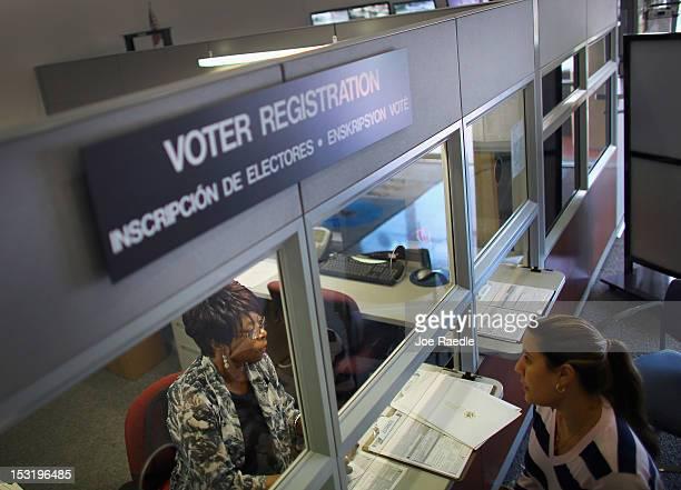 Dorothy Torrence from the MiamiDade Elections Department helps Viviana Camacho with information about her voter registration on October 1 2012 in...