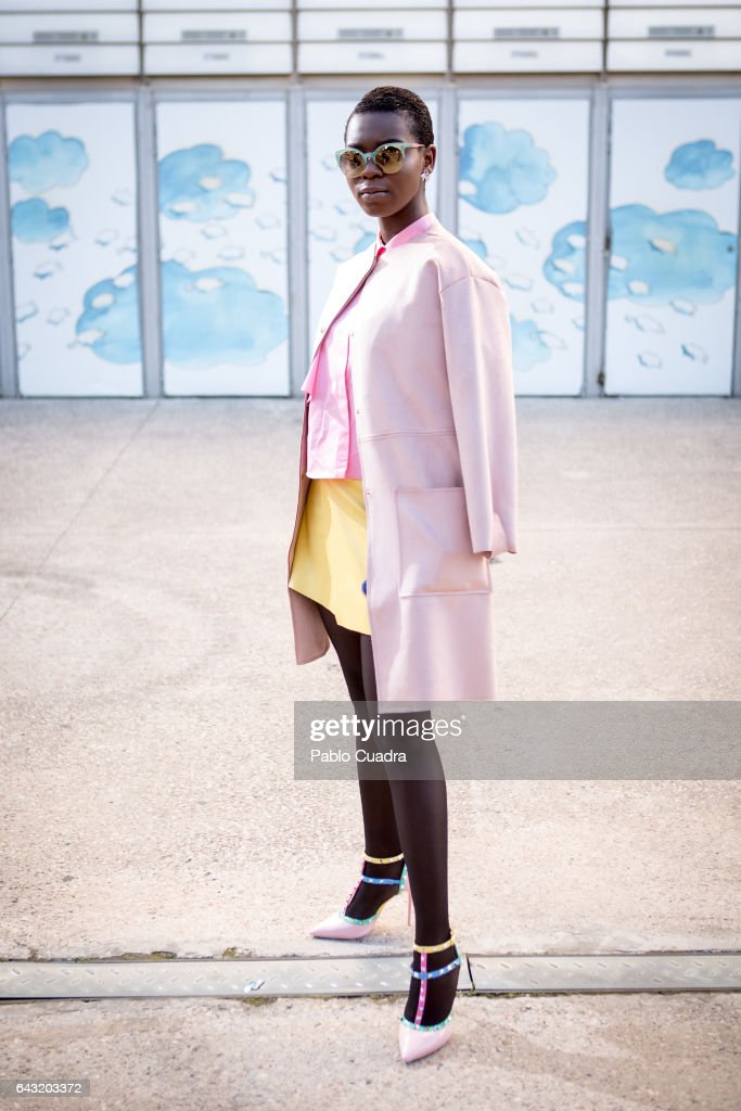 Dorothy wears Zara shoes, skirt, coat and handbag and Parfois sunglasses at Ifema during Mercedes Benz Fashion Week Madrid Autumn / Winter 2017 on February 20, 2017 in Madrid, Spain.
