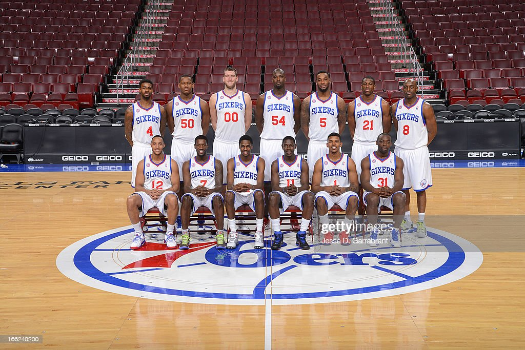 Dorrell Wright #4, Lavoy Allen #50, Spencer Hawes #00, Kwame Brown #54, Arnett Moultrie #5, Thaddeus Young #21, Damien Wilkins #8, Evan Turner #12, Royal Ivey #7, Justin Holiday #14, Jrue Holiday #11, Nick Young #1, and Charles Jenkins #31 of the Philadelphia 76ers pose for portraits at the Wells Fargo Center on April 10, 2013 in Philadelphia, Pennsylvania.