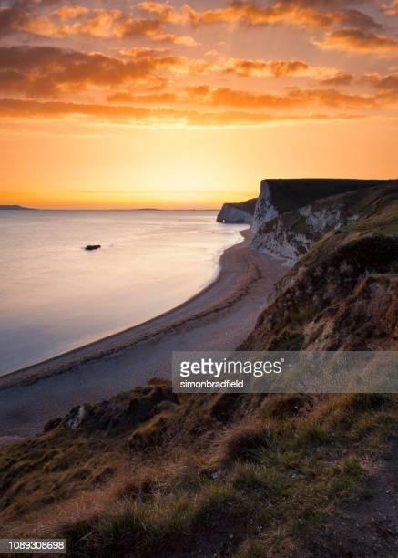 ドーセットのジュラシック海岸夕日複合 - 英国 ドーセット ストックフォトと画像