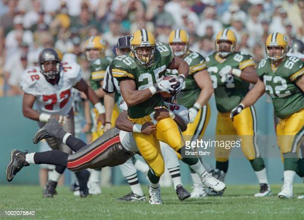 Dorsey Levens Running Back for the Green Bay Packers runs the ball during the National Football Conference Central game against the Tampa Bay...