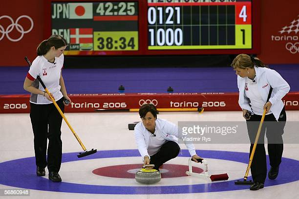Dorthe Holm Lene Nielsen and Malene Krause of Denmark compete during the preliminary round of the women's curling between Japan and Denmark during...
