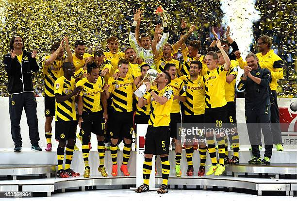 Dortmund captain Sebastian Kehl lifts the trophy following his team's 2-0 victory during the DFL Supercup between Borrussia Dortmund and FC Bayern...