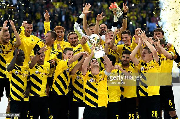 Dortmund captain Sebastian Kehl lifts the trophy following his team's 20 victory during the DFL Supercup between Borrussia Dortmund and FC Bayern...