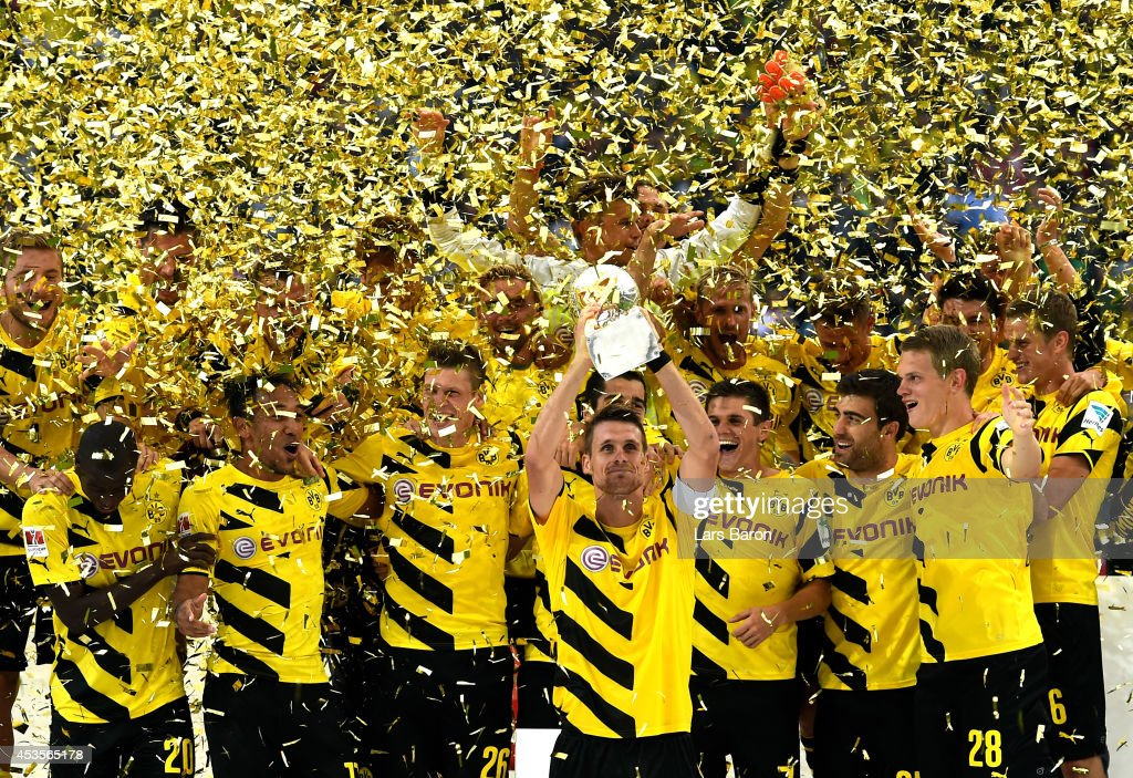 Dortmund captain Sebastian Kehl lifts the trophy following his team's 2-0 victory during the DFL Supercup between Borrussia Dortmund and FC Bayern Muenchen at Signal Iduna Park on August 13, 2014 in Dortmund, Germany.