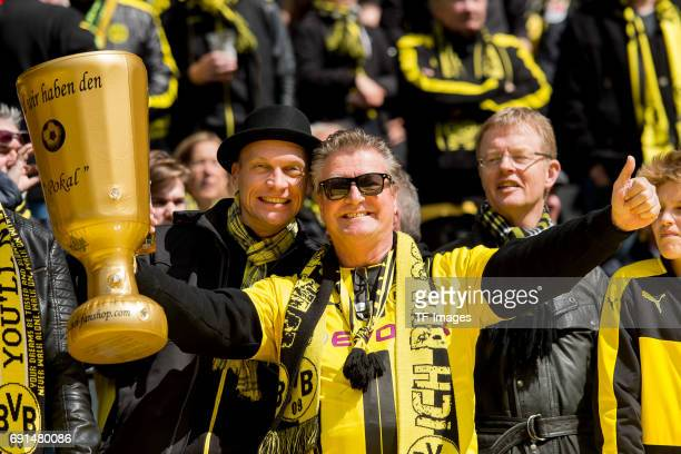 Dortmund fan holds a dummy of the German DFB trophy during the Bundesliga match between Borussia Dortmund and FC Koeln at Signal Iduna Park on April...