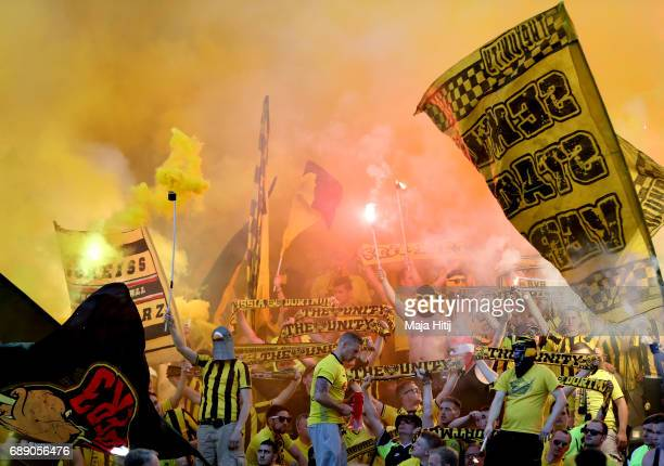 Dortmund fans burn flares during the DFB Cup final match between Eintracht Frankfurt and Borussia Dortmund at Olympiastadion on May 27 2017 in Berlin...