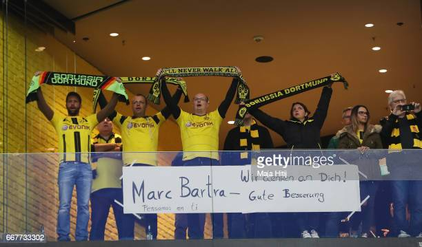 Dortmund fans display a message for Marc Bartra who was injured in the team coach attack during the UEFA Champions League Quarter Final first leg...