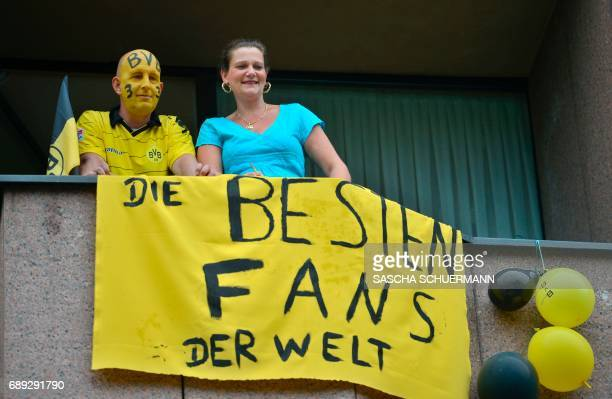 Dortmund fans hold a banner reading 'The best fans of the world' ahead celebrations of Bundesliga soccer club Borussia Dortmund after winning the...