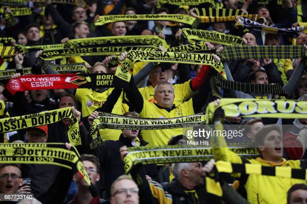 Dortmund fans hold up scarves during the UEFA Champions League Quarter Final first leg match between Borussia Dortmund and AS Monaco at Signal Iduna...
