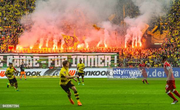 Dortmund fans light flares during the German first division Bundesliga football match Borussia Dortmund vs VfB Stuttgart, in Dortmund, western...