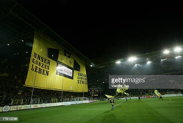 Dortmund fans roll out a huge banner prior to the DFB Cup second round match between Borussia Dortmund and Eintracht Frankfurt at the Signal Iduna...