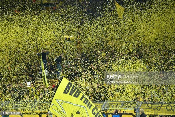 Dortmund fans throw confetti prior to the UEFA Champions League Group F football match Borussia Dortmund v FC Barcelona in Dortmund western Germany...