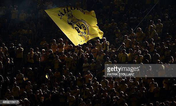 Dortmund fans wave the club's flag during the German first division Bundesliga football match Borussia Dortmund vs Hertha BSC in Dortmund Germany on...