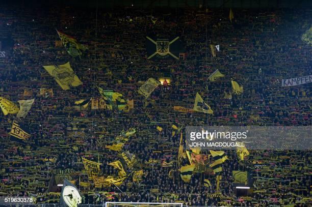 Dortmund fans wave their flags prior to the UEFA Europe League quarterfinal firstleg football match Borussia Dortmund vs Liverpool FC in Dortmund...