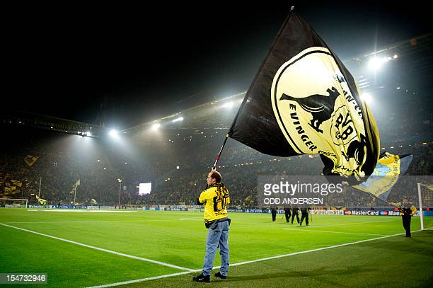 Dortmund fans wave their team flag prior to the UEFA Champions league group D football match between Borussia Dortmund and Real Madrid in Dortmund...