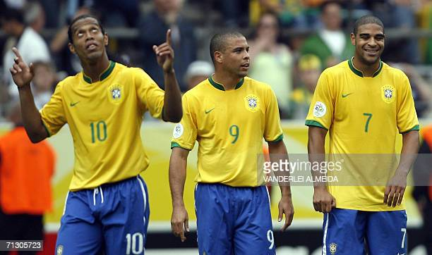 Brazilian forward Adriano celebrates after scoring his team's second goal with Brazilian forward Ronaldo who scored their first goal as Brazilian...
