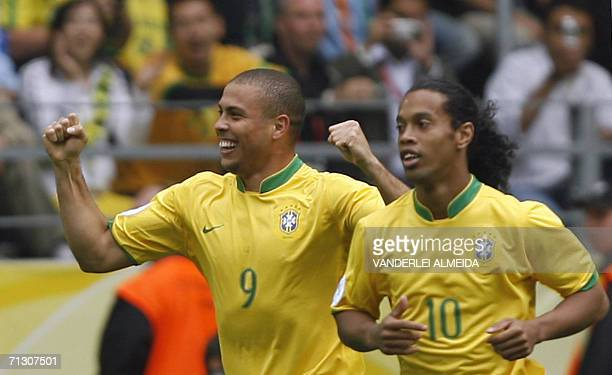 Brazilian forward Ronaldo celebrates with Brazilian midfielder Ronaldinho after scoring his team's first goal during the round of 16 World Cup...