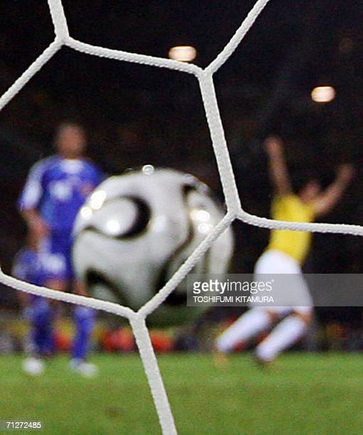 Brazilian midfielder Juninho scores during the opening round Group F World Cup football match Japan vs Brazil 22 June 2006 in Dortmund Germany AFP...