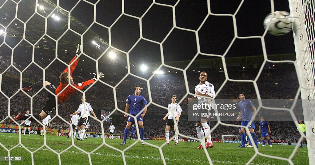 German goalkeeper Jens Lehmann (L) dives in vain to stop a shot by Italian defender Fabio Grosso (not pictured) during the World Cup 2006 semi-final football match Germany vs. Italy, 04 July 2006 in Dortmund. Italy won the match 2 - 0 after extra time.