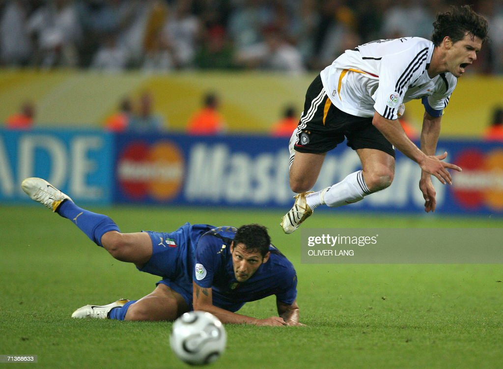 German midfielder Michael Ballack (R) is upended by Italian defender Marco Materazzi (L) during the semi-final World Cup football match between Germany and Italy at Dortmund's stadium, 04 July 2006. The match was scoreless during the second half.