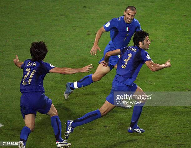 Italian defender Fabio Grosso celebrates next to Italian forward Alessandro Del Piero and Italian midfielder Andrea Pirlo after scoring the opening...