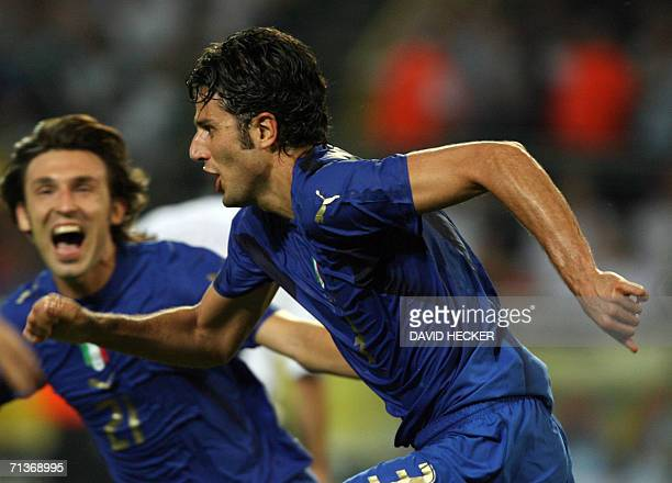 Italian defender Fabio Grosso celebrates with Italian midfielder Andrea Pirlo after scoring the first goal for his team during the 2006 Football...