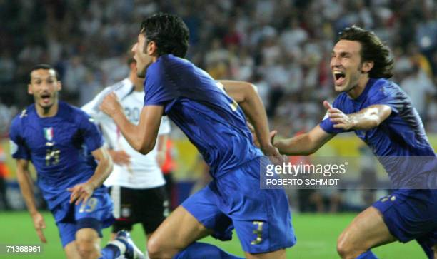 Italian defender Fabio Grosso is joined by Italian defender Gianluca Zambrotta and Italian defender Gianluca Zambrotta to celebrate Grosso's goal in...