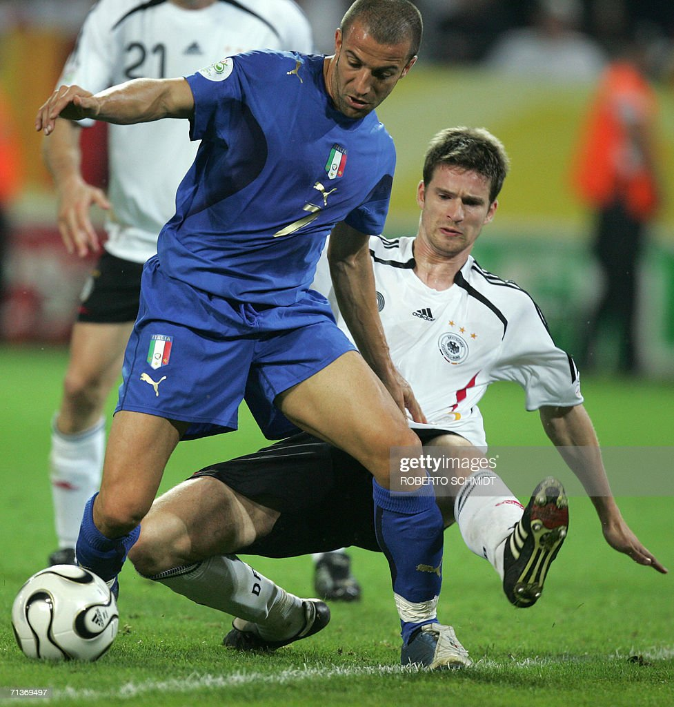 Italian forward Alessandro Del Piero (L) is challenged by German defender Arne Friedrich (R) during the semi-final World Cup football match between Germany and Italy at Dortmund's stadium, 04 July 2006. Italy won the match 2-0 in extra time to reach the final.