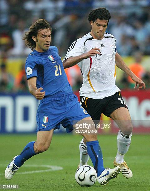 Italian midfielder Andrea Pirlo fights for the ball with German midfielder Michael Ballack during the semifinal World Cup football match between...