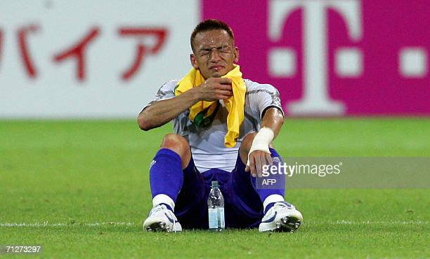 Japanese defender Hidetoshi Nakata sits on the pitch at the end of the opening round Group F World Cup football match Japan vs Brazil 22 June 2006 in...