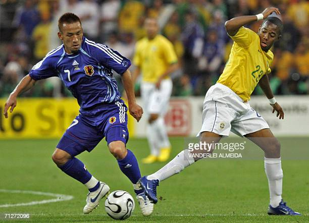 Japanese midfielder Hidetoshi Nakata vies with Brazilian forward Robinho during the opening round Group F World Cup football match Japan vs Brazil 22...