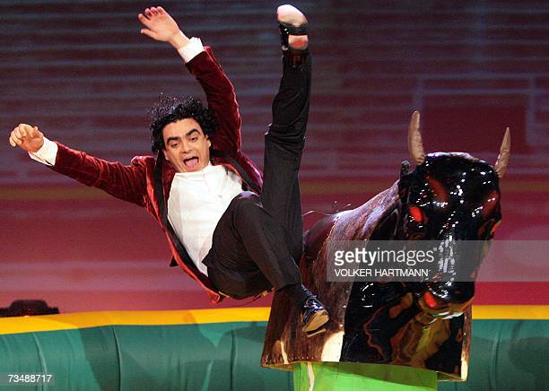 Mexican tenor Rolando Villazon falls off a machine bull 03 March 2007 during the live broadcast of German TV game show 'Wetten dass ' in Dortmund...