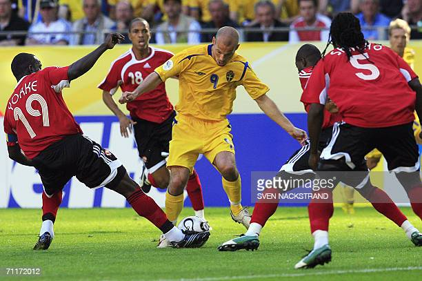 Swedish midfielder Freddie Ljungberg vies with Trinidad and Tobago's forward Dwight Yorke and teammate defender Brent Sancho during the 2006 World...