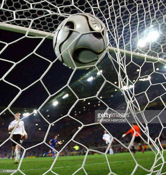 The ball enters the net of the German goal post during the 2006 FIFA World Cup semifinal match between Germany and Italy 04 July 2006 in Dortmund...